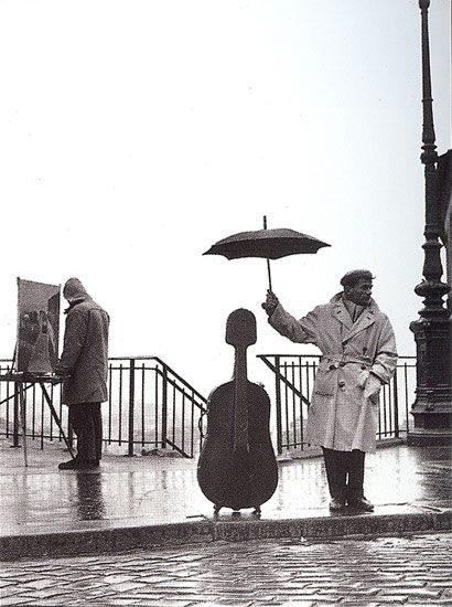 Robert Doisneau - Musician in the rain (1957)